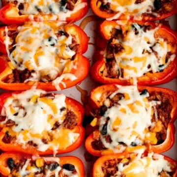 Mexican stuffed peppers are a delicious, wholesome, healthy meal loaded with fun Mexican flavors. It freezes well and is perfect for meal prep. | aheadofthyme.com