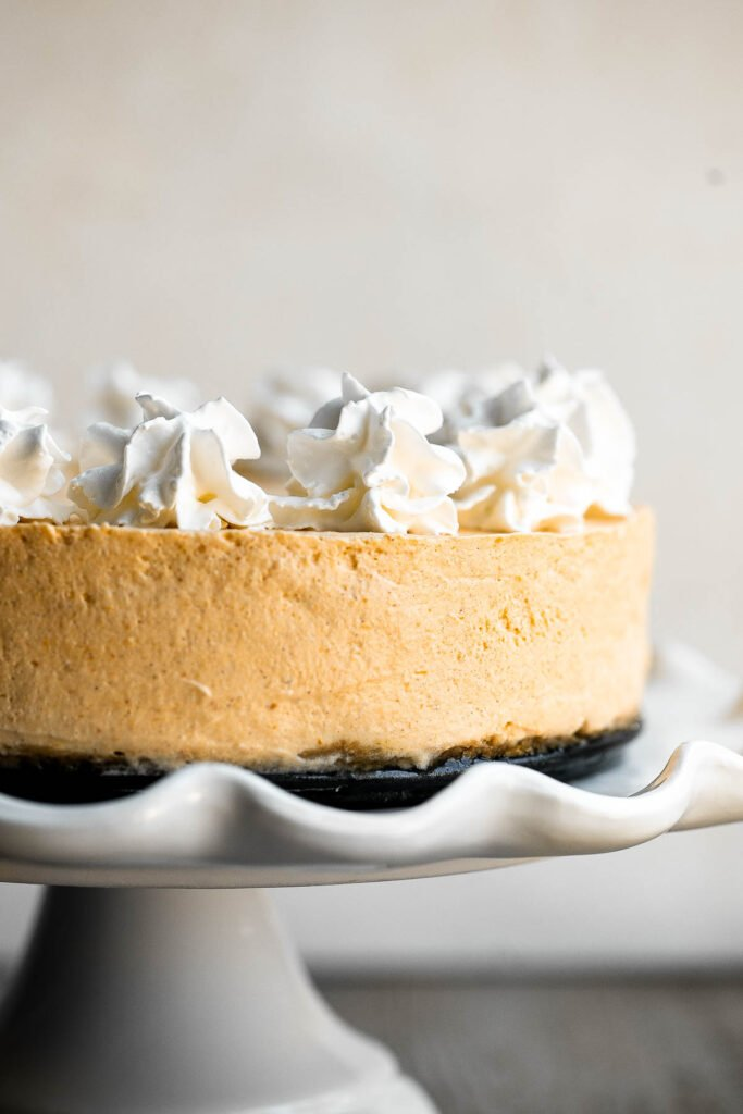 No bake pumpkin cheesecake is the easiest cheesecake to make this fall. It's light, smooth, creamy, and loaded with fall flavors like pumpkin and cinnamon. | aheadofthyme.com