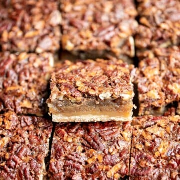 Pecan pie bars are the best and easiest way to enjoy the flavors of pecan pie but with half the effort and in a handheld bite-sized form. | aheadofthyme.com