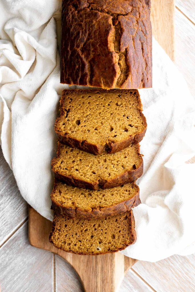 Pumpkin bread is fluffy, moist, and delicious. This classic fall loaf cake is loaded with real pumpkin and seasonal spices like cinnamon and ginger. | aheadofthyme.com