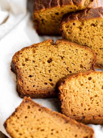 Pumpkin bread is fluffy, moist, and delicious. This classic fall loaf cake is loaded with real pumpkin and seasonal spices like cinnamon and ginger.   aheadofthyme.com