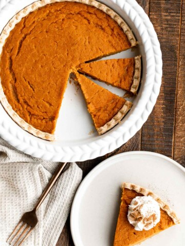 Sweet potato pie is warm and cozy, spiced with classic fall flavors, and delicious. Easy to make with cooked sweet potatoes or canned sweet potato puree.   aheadofthyme.com
