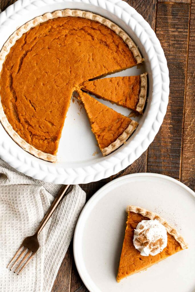 Sweet potato pie is warm and cozy, spiced with classic fall flavors, and delicious. Easy to make with cooked sweet potatoes or canned sweet potato puree. | aheadofthyme.com