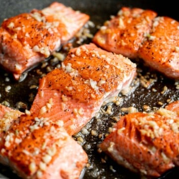 Tender, flaky, flavorful garlic butter salmon is well-seasoned, seared to perfection, and basted until juicy. Quick and easy to make in 20 minutes. | aheadofthyme.com